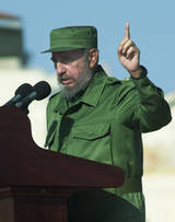 Fidel Castro extolling the virtues of a straight - but artificial - Christmas tree!