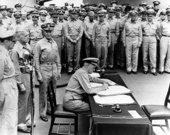 Admiral of the Fleet Chester W. Nimitz at Japanese surrender Behind him stand MacArthur, Halsey and Admiral Forrest Sherman