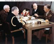 "Leahy, left, and King, top right, in conference with Generals George C. Marshall, right, and Henry ""Hap"" Arnold, top left"