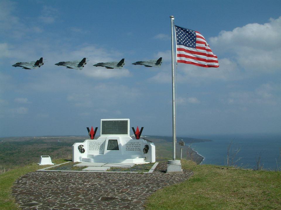 USMC jets pass in tribute the memorial on Mount Suribachi, Iwo Jima